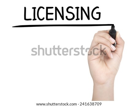 Hand with pen writing LICENSING on whiteboard - stock photo