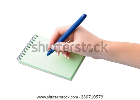 hand with pen writing on notebook on white background