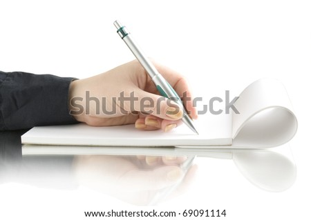 hand with pen writing on the notebook and reflection - stock photo