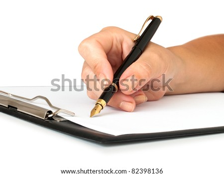 hand with pen writing on the page with clipboard