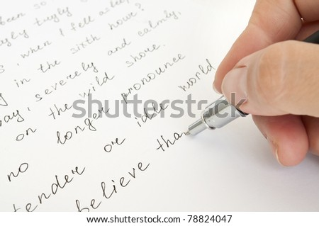 hand with pen writing on the sheet - stock photo