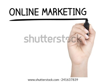 Hand with pen writing ONLINE MARKETING on whiteboard - stock photo
