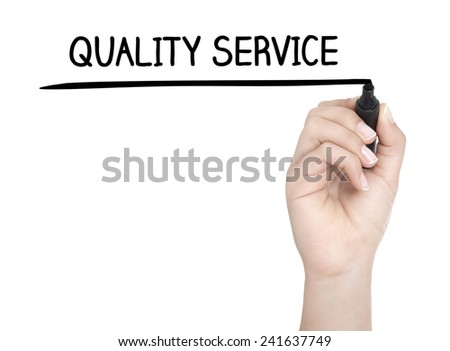 Hand with pen writing QUALITY SERVICE on whiteboard - stock photo