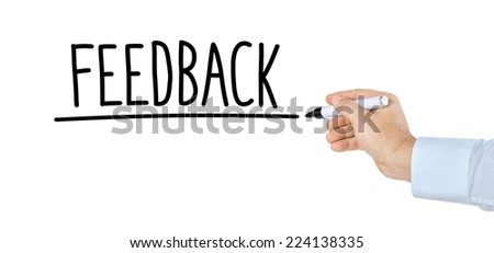 Hand with pen writing the word Feedback - stock photo