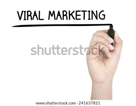 Hand with pen writing VIRAL MARKETING on whiteboard - stock photo