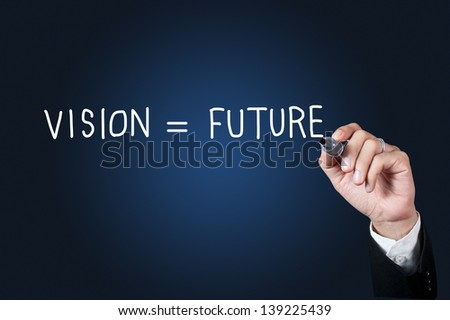 Hand with pen writing vision and future on whiteboard - stock photo