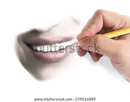 hand with pencil draws the smile  - stock photo