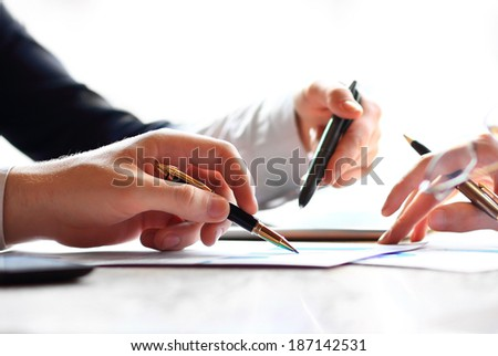 Hand with pencil. Finance and accounting business. - stock photo