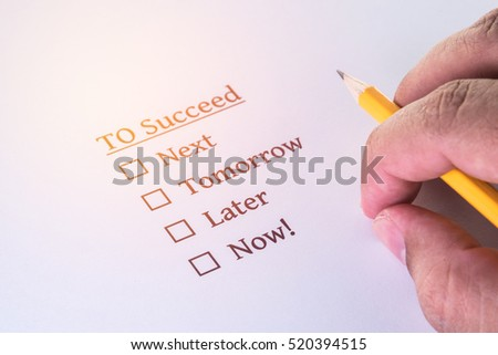 hand with pencil over survey form