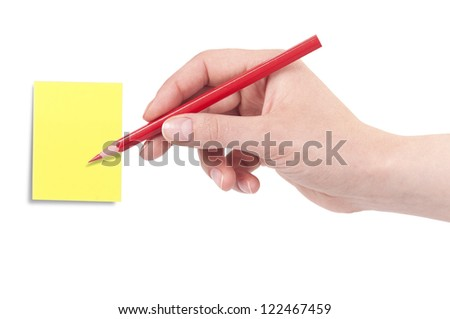 Hand with pencil ready to note a message on a color sticker isolated