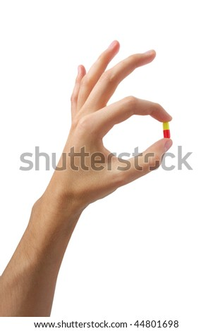 Hand with pill. Element of medical design. - stock photo