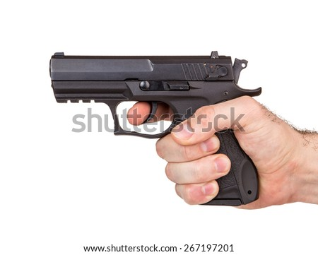 Hand with pistol isolated on white background - stock photo