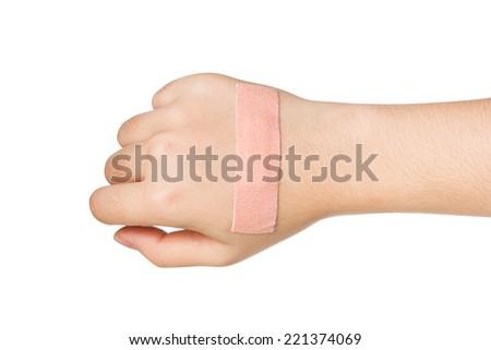 Hand with plaster bandage isolated on white background. - stock photo
