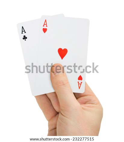 Hand with poker cards isolated on white background - stock photo