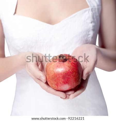 hand with pomegranate isolated on white - stock photo