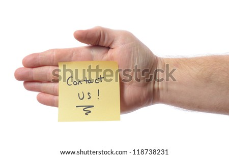 Hand with post it note saying contact us isolated on white - stock photo