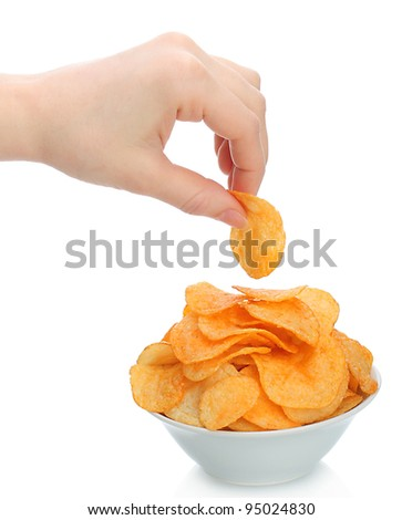 Hand with potato chips  and bowl on white background - stock photo