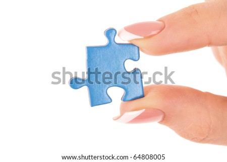Hand with puzzle isolated on white - stock photo
