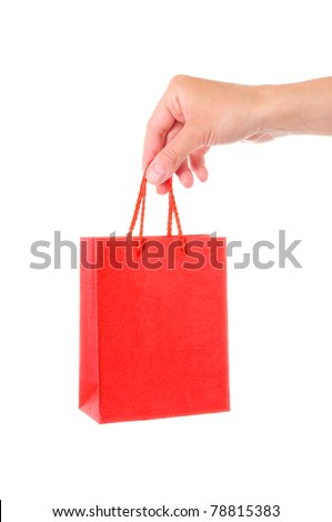 Hand with red bag, isolated on white background - stock photo