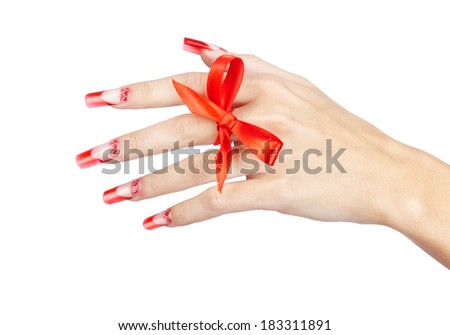 Hand with red french acrylic nails manicure and painting with bow on finger isolated  white background