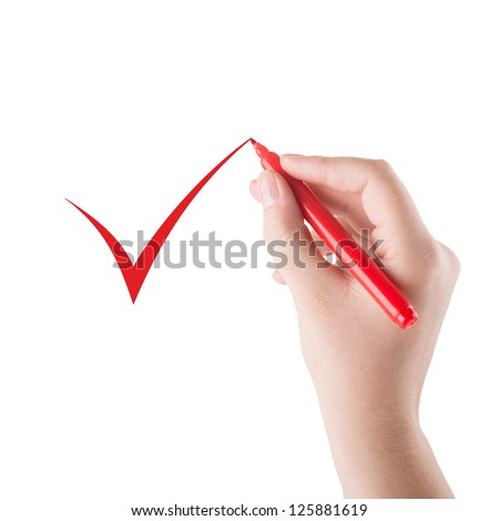 Hand with red marker draws a mark - stock photo