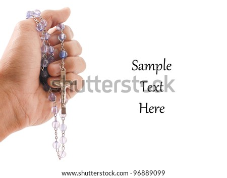 Hand with Religious Rosary with Space For Text - stock photo