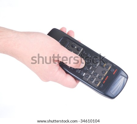 Hand with remote control - stock photo
