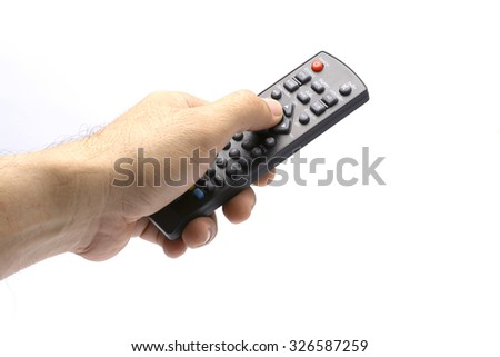 Hand with remote control at white