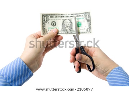 Hand with scissors, cutting one dollar bill - stock photo