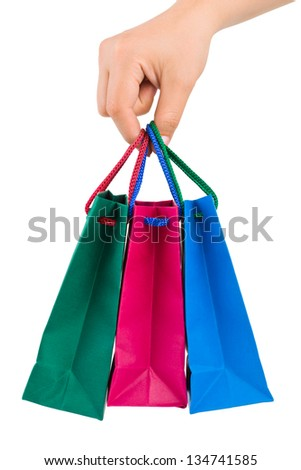 Hand with shopping bags isolated on white background - stock photo