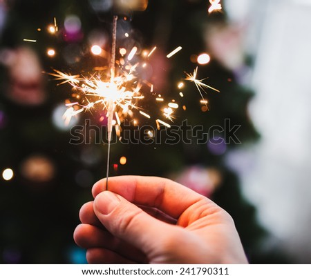 Hand with Sparkler  - stock photo