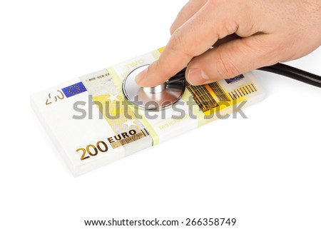 Hand with stethoscope and money isolated on white background - stock photo