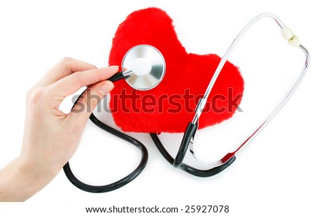 Hand with stethoscope checking a red heart isolated on a white background - stock photo