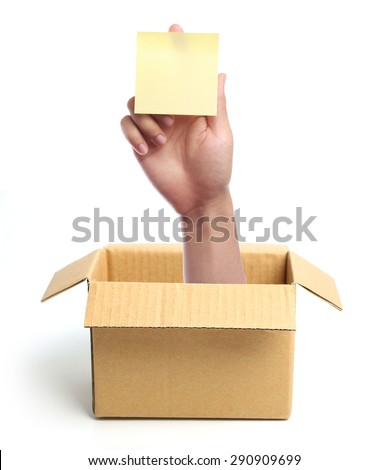Hand with sticky note is out of box isolated on white. - stock photo