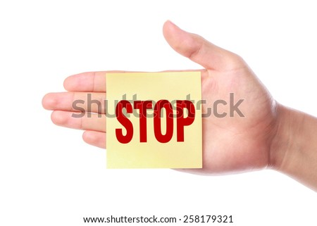 Hand with Stop note is isolated on white background. - stock photo