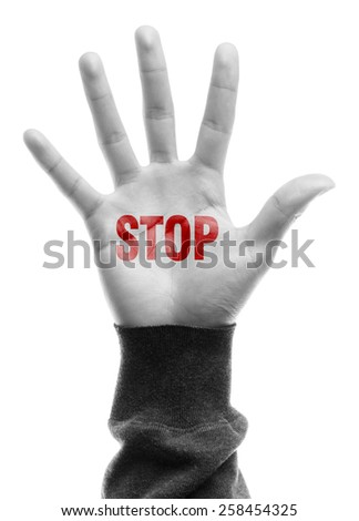 Hand with Stop text is isolated on white background. - stock photo