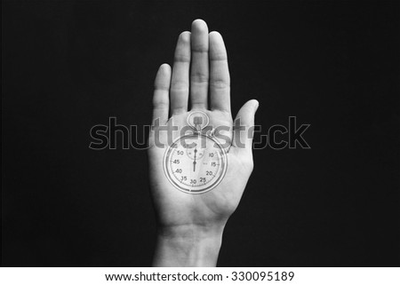 Hand with stopwatch - stock photo