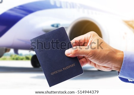 Hand with Thailand passport with airplane background