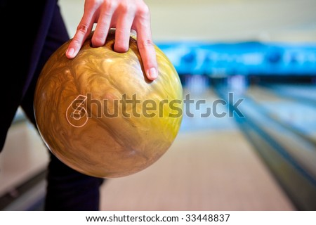 Hand with the bowling ball - stock photo