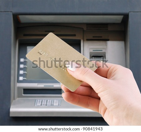 hand with the credit card at the atm - stock photo