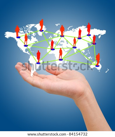 Hand with the map of social network on blue background - stock photo