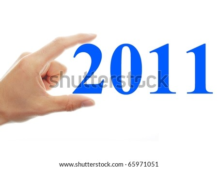 hand with the number 2011 isolated on white background - stock photo