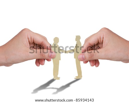 Hand with the paper cut of two business man - stock photo