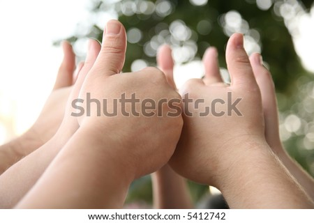 hand with the raised thumbs - stock photo