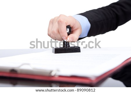 Hand with the seal, stamping the contract, close up - stock photo