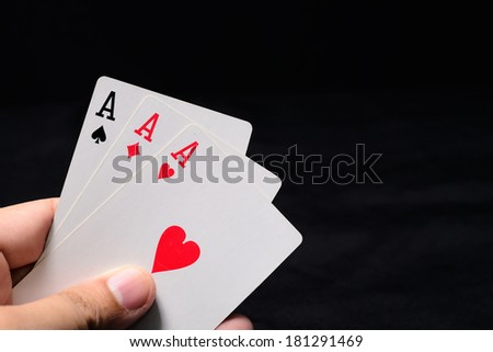 Hand with three aces - stock photo
