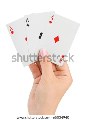 Hand with three aces isolated on white background - stock photo