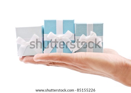 Hand with Three Ring Gift Boxes - stock photo