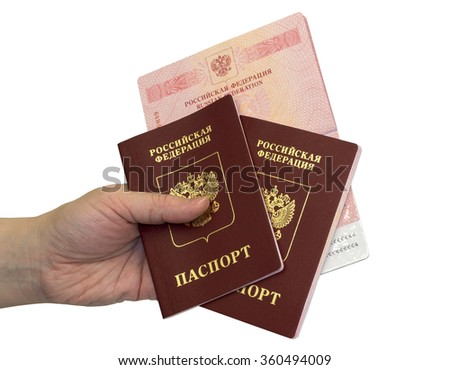 Hand with three russian passports on white background