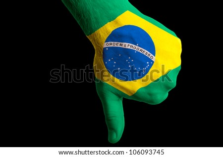 Hand with thumb down gesture in colored brazil national flag as symbol of negative political, cultural, social management of country